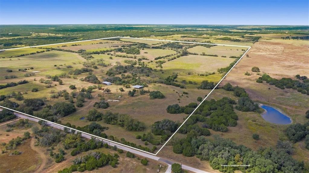 This unrestricted property in Burnet is in a prime location.  Acres of breathtaking flat to gently rolling terrain with sandy loam soil is a rare find. This scenic property has three water wells, an open metal barn est. 50'x40' with one closed room about 16'x16' on a slab. A second open metal barn is approximately 50'x50' is used for equipment storage. Beautiful, large oak trees and pasture and available electricity make this acreage an ideal private ranch, RV park, or future development.  The acreage location should make an easy commute to Burnet, Bertram, Liberty Hill, Georgetown, Leander, and Austin. Buyer to verify all listing information.