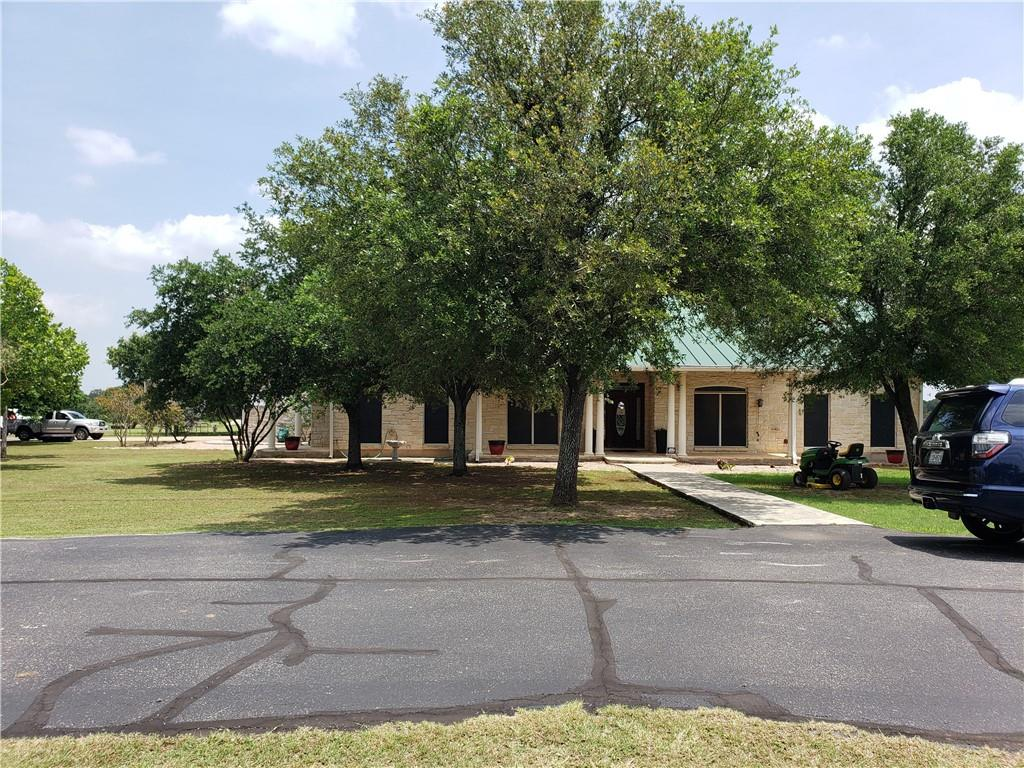 Located in the Georgetown ETJ, this custom built home sits on 10 acres (7 are AG exempt, 3 acres currently yard space for a trucking company that is relocating upon sale). Horse stable (1680 SQ FT) has been converted to office space w 4 offices, conference room, and restroom. Office above garage. Residential or commercial use.