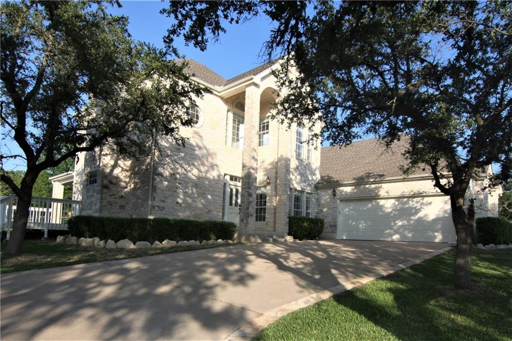 Large Wooded Lot with majestic Live Oaks in a Restricted Country Subdivision.  Close to Belterra Shopping and Eateries....Highly Acclaimed Dripping Springs Schools.  Must see to appreciate. Seller has re-done and replaced with many new upgrades.Perfect Large Workshop with Drive Thru- 3 Overhead doors and entry door.  Carport parking along with 2 car attached garage at the home.  5 Bedroom Home that can be easily converted to your home office.  Country Distant Views.  Home has been designed with Natural Light.  Solid Wood flooring with a bit of hard tile.  This oversized 1.7+/- acre Lot allows you to observe nature at it' finest.  Many Whitetail deer and wildlife frequent the area.  Kitchen complete with new steam oven microwave.  Kitchen has storage for the gourmet cook.  Walk in pantry. Perfect fro adding an outdoor pool or outdoor kitchen.  Great outdoor space for entertaining. Ample parking for Guests.