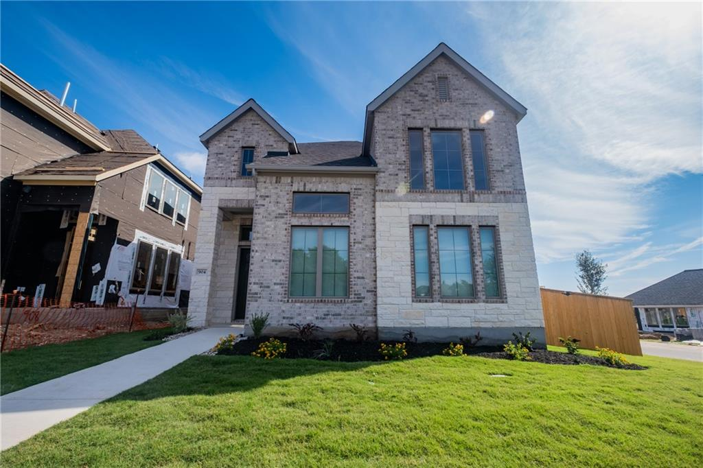 New construction, never lived in, nicely upgraded garden home with 4 bedrooms, 3.5 bathrooms, a game room, and a covered outdoor patio. Many upgrades throughout the house including luxury vinyl plank flooring on first level, upgraded countertops, cabinets, stairs, floor/wall tiles, carpets, blinds, electric, and kitchen/bath hardware. Two-story entry and family room with 19-foot ceiling. Open concept floor plan with a kitchen island that offers built-in seating space, and a separate dining area with a wall of windows. Secluded primary suite on first level offers a French door entry to the primary bath with dual vanities, a large glass enclosed shower and a walk-in closet. The second level boasts a large game room, a guest suite with a full bath and two secondary bedrooms with a shared bath. Mud room just off the two-car garage. Corner lot about 4620 sqft, garage with full driveway on back, and across street from beautiful community park. Brand new Elementary School in the community is within walking distance.