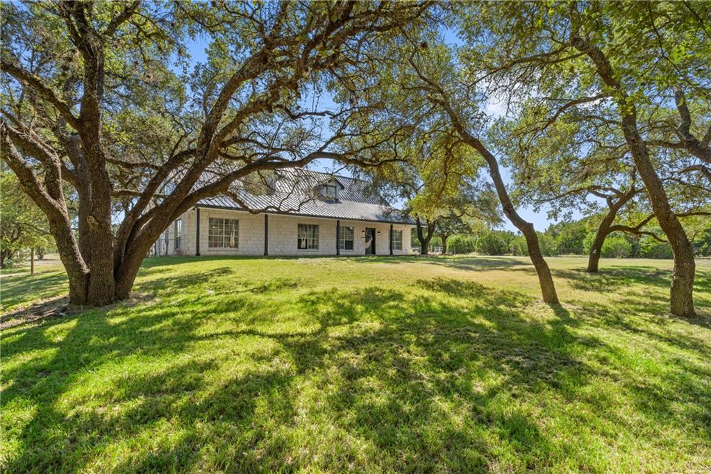 Modern American Dream House on surprisingly central 5 acres!  Complete modern remodel down to the studs during 2021 on an already epic and unique lot.  Home includes luxury appliance package, hardwood floors, oversized kitchen loaded with cabinetry, multiple storage closets throughout home complete with built in shelvings and rods, as well as whole house insulating blinds.  Garage is oversized for two cars, fully air conditioned and has room for a workshop on the ground level, with a one bedroom and one bath apartment above.   Multiple live oak tree orchards cover the front of the lot, while the back is dotted with cedar tree and wild flower orchards.  The middle of the lot contains a large animal enclosure and a covered chicken coop.  The near back yard is plenty big enough for a pool to add to the current kids playscape and horse shoe pit.  Also on the lot is a 2400 sq/ft warehouse/workshop (60% HVAC) complete with 3-phase 200 amp power.
