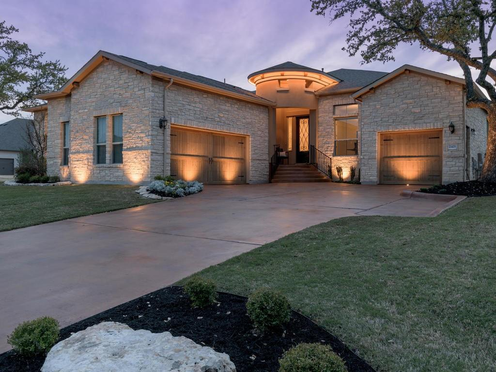 Be prepared to fall in love when you see this stunning, like-new home in Crystal Falls. Designer detailing abounds in the spacious, open concept floor plan between the beautiful luxury vinyl plank flooring, tray ceilings with crown molding and oversized sliding glass doors that allow an abundance of natural light to pour inside. A great flex space at the front of the home, with a private side patio, has so many uses; formal living, formal dining, game room, play area; the perfect spot for entertaining. The floor to ceiling sliding glass doors in the living room were designed to maximize sunshine throughout the day while a beautiful gas log fireplace creates a warm and welcoming ambiance. The gourmet kitchen is every chef's dream with an oversized island for prepping and serving, tons of cabinet storage and high-end stainless appliances. Gorgeous granite countertops are perfectly complimented by the white cabinetry, tile backsplash and lovely lighting. Stainless steel appliances include a chef grade, gas cooktop, range hood, built-in double ovens, microwave and dishwasher. Drift peacefully off to sleep every night in the luxurious owner's suite with a high ceiling, crown molding, walk-in closet and a spa-like ensuite bath that boasts dual vanities, an oversized walk-in shower and a relaxing soaking tub. Sitting on almost half an acre, corner lot, the wonderful backyard boasts plenty of room for a garden, pool, playscape, expansive patio or anything else that you desire. This home is perfectly situated right in between downtown Leander and downtown Cedar Park, giving you a plethora of shopping and dining options. Crystal Falls Pkwy is within a hop, skip and a jump from the home, allowing you quick access out of the neighborhood. This home is also just down the street from Crystal Falls Golf Course and Whitestone Elementary School. An opportunity to purchase such a gorgeous and unique home doesn't come around often, so schedule your showing before it's too late!