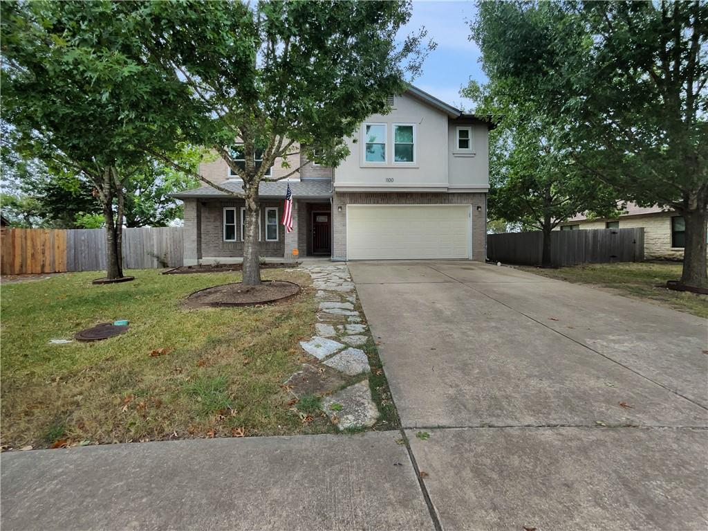 This Pflugerville two-story home offers a patio, and a two-car garage.