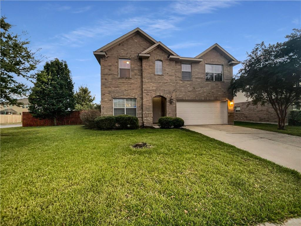 This Pflugerville two-story corner home offers granite countertops, and a two-car garage.