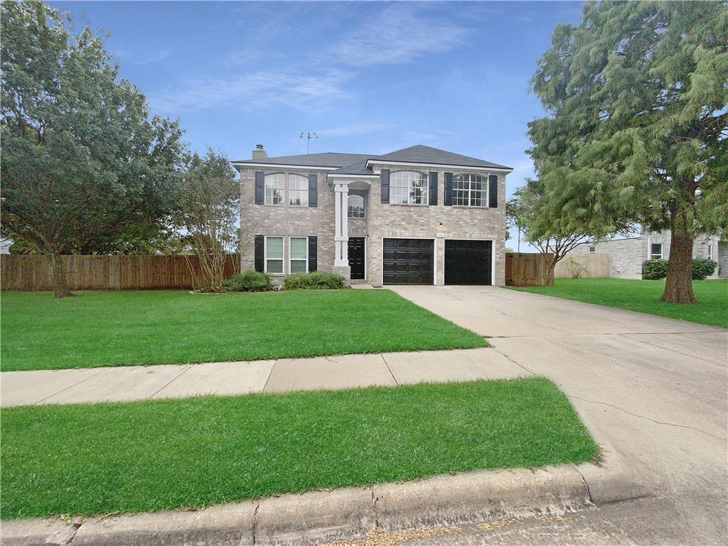 This Round Rock two-story home offers granite countertops, and a two-car garage.