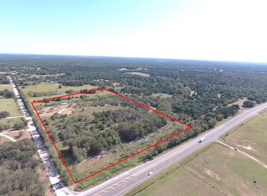 20 acres on Highway 21 with no restrictions and no flood plain! Great potential for residential or commercial development. Fantastic location 11 miles from Bastrop and 3 miles from Highway 290. Easily subdivide into lots with a total of 799 feet of frontage on Highway 21 and 1092 feet of frontage on S. Old Potato Road. This beautiful wooded property is mostly fenced and conveys with a nice 3 bedroom 2 bathroom mobile home, 2 storage buildings, wet weather creek, and a small pond! Utilities include a septic system, Aqua water meter, and electricity.