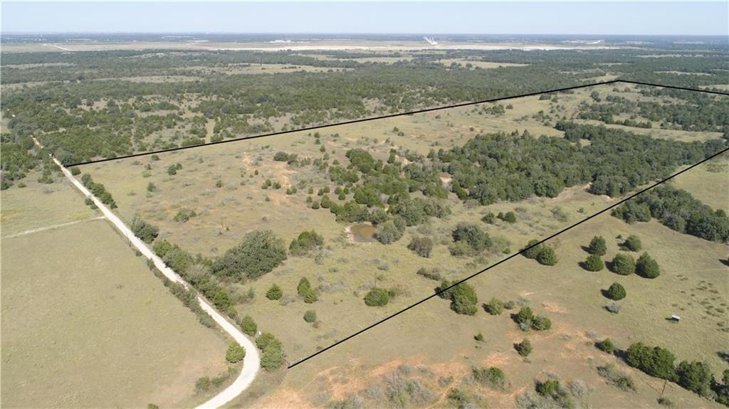 Room to Roam and Build your Dream Home on this secluded 60.63 acres. Come enjoy your paradise! This prime property has road frontage on CR 102 also known as Lexington Road. Regardless if you are a developer or looking for the perfect location to build a private estate, you will be hard pressed to find this level of privacy so close to Austin - one of the most desirable cities in the great Lone Star state. To tour this remarkable property, please contact Kathryne Roddam at Keller Williams, and make this perfect investment opportunity today!