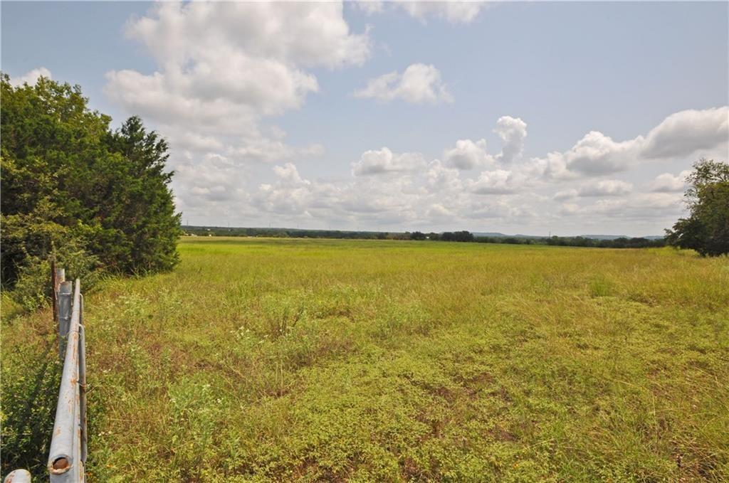 Approx. 10 acres to be subdivided out of larger tract. Great paved road frontage. Ag exempt. More land available in adjacent tracts. New survey will be required, legal description to be based on new survey. Quiet location close enough to the city. Approx 1 hour from Austin Airport, 30 min to Georgetown, 15 minutes from Killeen Ft Hood Regional Airport. Water well needed. Light restrictions to conserve property values. Newer mobile homes welcome (2017+), Barndominiums ok too.