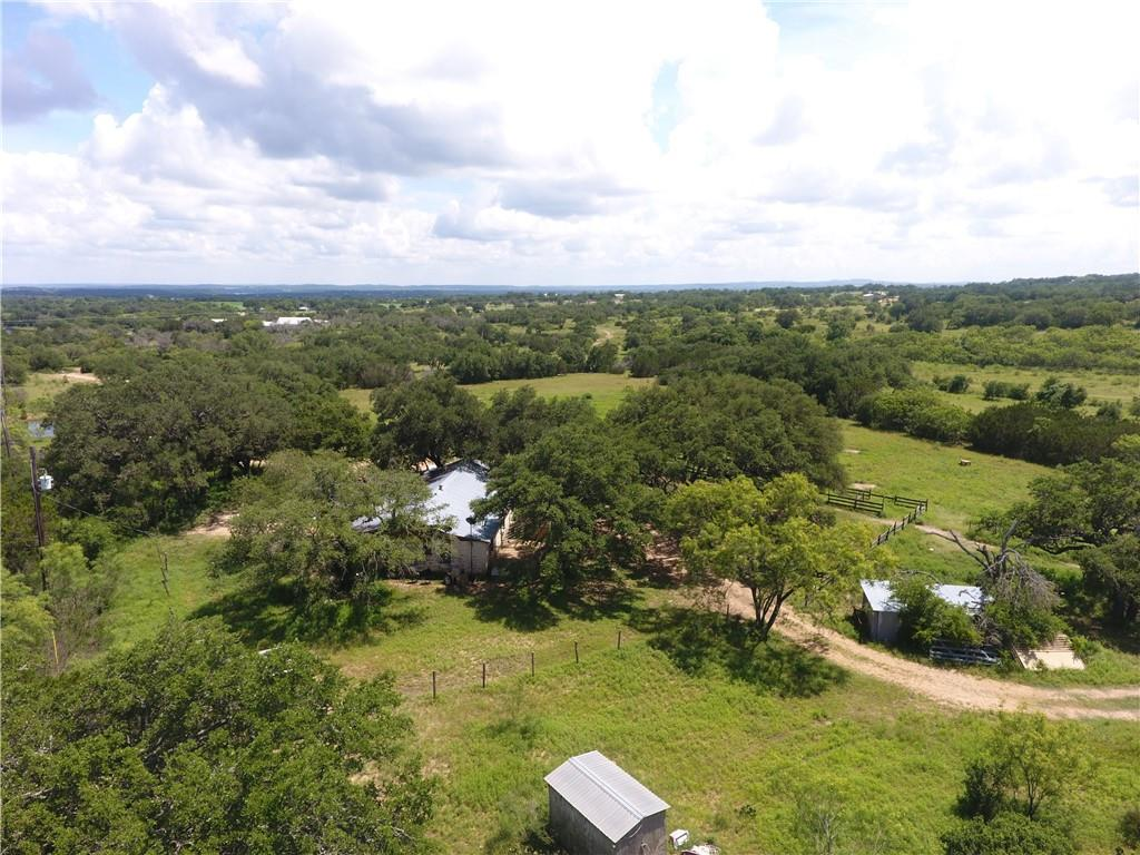 25± Acres Hickory Creek Ranch, Burnet County 10930 FM 1431, Marble Falls, TX 78654 Description: Situated less than ten minutes from Marble Falls, Hickory Creek Ranch is a great opportunity to own a private unrestricted retreat just a short drive from upper lake Travis. Whether you are an avid outdoorsman or simply enjoy having space from your neighbors this property has it all with live water Hickory Creek, majestic live oaks and gently rolling hills with long distance views.  Improvements: structural improvements include an approximately 1,600 sf three bed, two bath, ranch style house. An all weather rock road traverses from the gate to the house with a concrete crossing on Hickory Creek. A cut out shooting range is also located towards the back end of the property. Water: One water well equipped with an electric submersible pump supplies water to the house, barn and water troughs.  Vegetation and Terrain: Gently rolling terrain with scenic views of the surrounding hill country make this the perfect getaway. A highlight of the property is that there is a good number of scattered live oaks paired with lush pasture land suitable for a few cattle or horses. Some native brush and cedar have been left as cover for wildlife.                                                                     Wildlife: An abundance of wildlife calls the property home including native species such as whitetail, turkeys, hogs and varmints along with occasional free ranging axis.