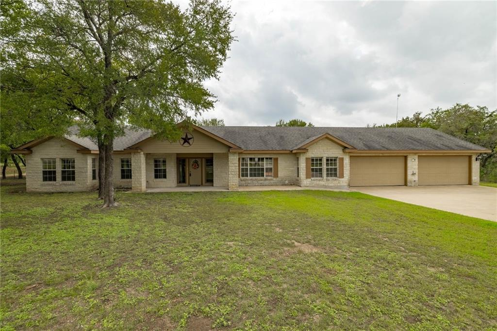 This beautiful 2489 Sq Ft home sits on 2.060 wooded acres. Features include 4 bedrooms, 2.5 baths, 1 living room and a second living and/or dining room. The kitchen showcases Silestone countertops, stainless appliances, electric slide-in range, microwave, dishwasher, oversized kitchen sink, center island and a dining area full of natural light. Just outside the kitchen is an extra large deck perfect for entertaining and watching the stars at night. The family room features wood floors and a wood burning fireplace. Gated driveway and oversized parking pad makes for plenty of room to park in your 4-car garage. The spacious yard allows room to add a future pool, RV pad or boat parking. The possibilities are endless. You don't want to miss this one! Carpet installed 10/2021. Home has two AC units; one was replaced in 2017 & the other was replaced in 2020. Primary bedroom closet floor has an entrance to the underground storm cellar. *Buyer to independently verify all information.*