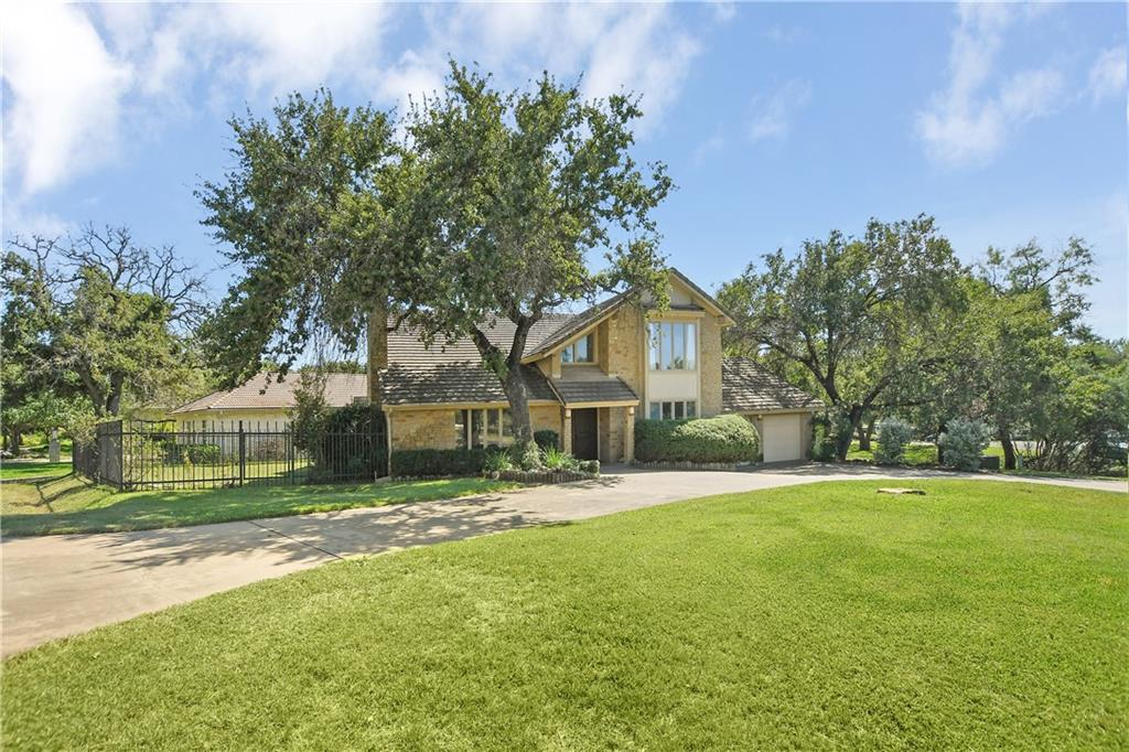 Welcome to 101 Burr Oak in the heart of Horseshoe Bay, Texas! Located just minutes from the popular Slick Rock Golf Course and the Horseshoe Bay Resort, this location is ideal for all! Nestled on a nearly half acre - corner lot, you have plenty of space in the middle of town. With a large circle driveway, parking during large gatherings will not be an issue either! When you enter into the home, you'll find the foyer and large living area that features very high ceilings and a gorgeous wood burning fireplace! The living room opens up into the dining area and eat-in kitchen. The kitchen has a nice layout, ample storage and a good size pantry. Off of the kitchen, you'll find the laundry room with additional storage and a door that leads to the oversized garage! Inside the garage, there is a storage closet, golf cart garage, and room for two full size vehicles as well. Back inside, you'll find a fabulous primary suite and additional half bath to finish up the main floor. When you get upstairs, you'll enter into a large loft/family room area - this is another great space for guests! Another thing to note about this home, is the fact that every bedroom is huge and they all offer en-suite bathrooms. This home has been well maintained and is ready for a new owner! Located 45 minutes from Austin and 1.5 hours from San Antonio, come enjoy the luxury hill country lifestyle that Horseshoe Bay offers! You'll be a short golf cart ride from Lake LBJ, fine dining, and renown golfing! Find yourself at HOME here!