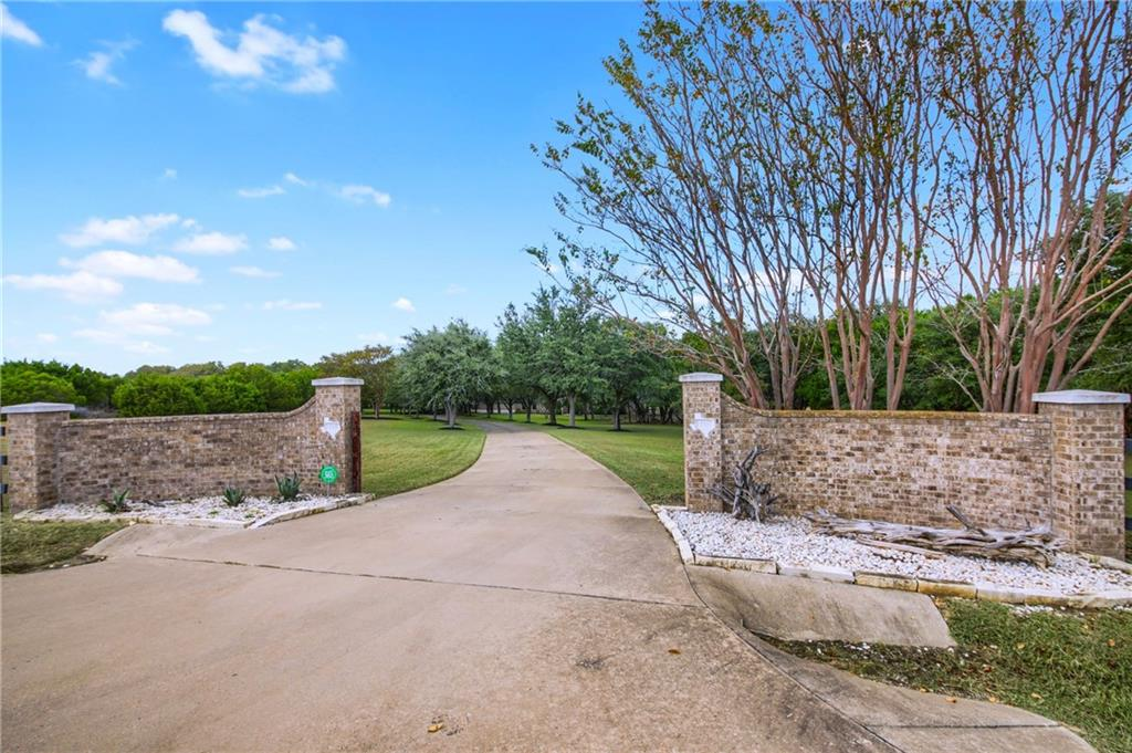 Welcome to your countryside retreat -- without sacrificing location! This stunning home is settled on an impressive 5.318 acres backing to lush, greenbelt scenery of Brushy creek. Nothing says extravagance like a welcoming, grand entrance with a manicured, tree-lined driveway right to your expansive front yard. There's more than enough parking for you and your guests, as the property boasts 2 detached garages for a total of 11 spaces! Upon entering the home, you'll notice the beautiful wood flooring and formal dining room. The spacious family room has a wonderfully situated fireplace and opens up to the kitchen and breakfast area with pool views throughout. The kitchen is equipped with a sufficient array of cabinet and counter space, beautiful black granite countertops, kitchen island, and skylights in the breakfast area and lots of window providing plenty of natural light for cooking and meal gatherings. The generous master suite is on the main floor with plush carpet, a larger sitting area and windows overlooking the pool and backyard. The massive master bath yields dual vanity sinks, hard tile floors, a jetted tub for soaking in after a long day's work, and a glass walk in shower. Study room/office with built-in shelving is located on the second floor along with the other 4 spacious bedrooms. An added enormous bonus room awaits you on the 3rd floor, which you can transform into anything you wish. Fresh paint and over $12K in Hunter Douglas window treatments throughout the house. Above the left 4.5 detached garage you will find a garage apartment that is ready to be finished out. Outside you will love the spectacular in-ground pool area surrounded by the abundant acreage that has been cleared. Up to 4 horses are allowed on this Texas-size property, has no HOA, guaranteed to make you feel as if you're on a private getaway.