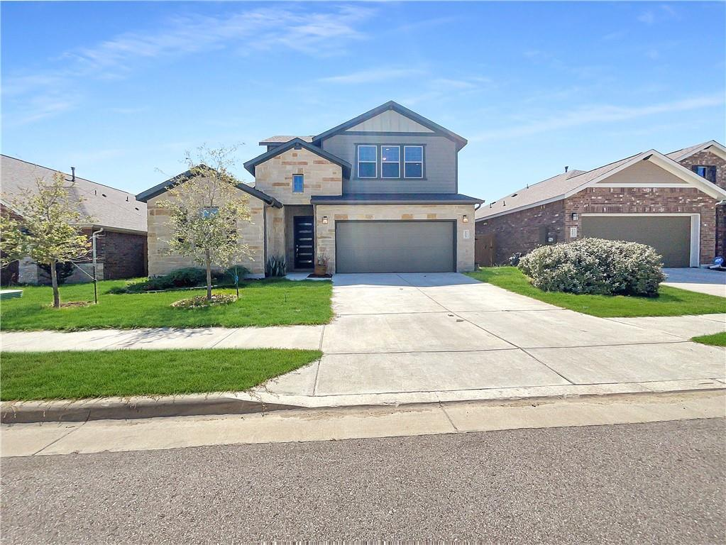 Built in 2018, this Hutto two-story home offers a patio, granite countertops, and a three-car garage.