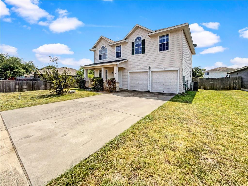 This Hutto one-story home offers a two-car garage.