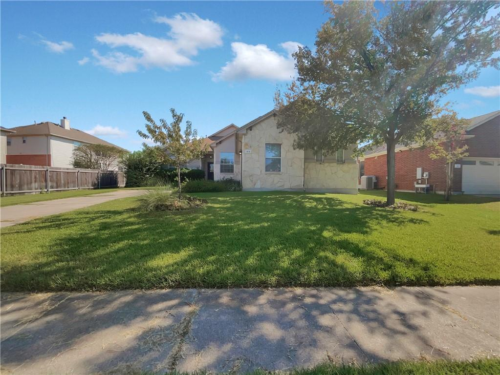 This Pflugerville one-story home offers a patio, and a two-car garage.