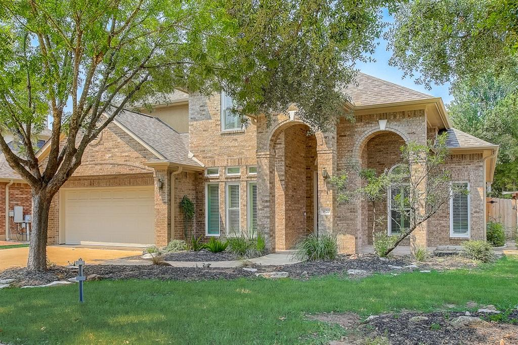 This Round Rock two-story home offers a patio, granite countertops, and a three-car garage.