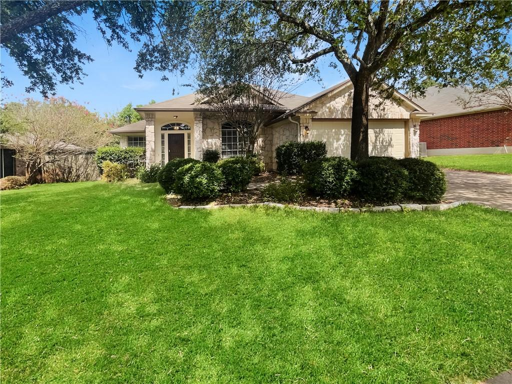 This Round Rock one-story home offers a patio, granite countertops, and a two-car garage.