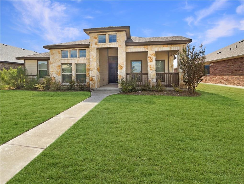 Built in 2017, this Pflugerville one-story home offers granite countertops, and a two-car garage.