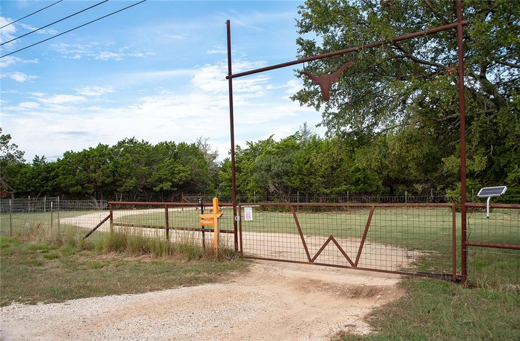 Texas ranch-style home nestled on 10.87 acres among trees, native vegetation, and a Texas Hill Country scenic view from the ranch-style balcony.  Traditional low wire fence for current livestock, native wildlife, trees, and a pasture to roam for that great Texas outdoor living.  Located just down the road from Lake Georgetown, shopping, hospitals, hiking trails, and recreational fun.  Come discover what opportunities you may find living in the beautiful Texas Hill Country.