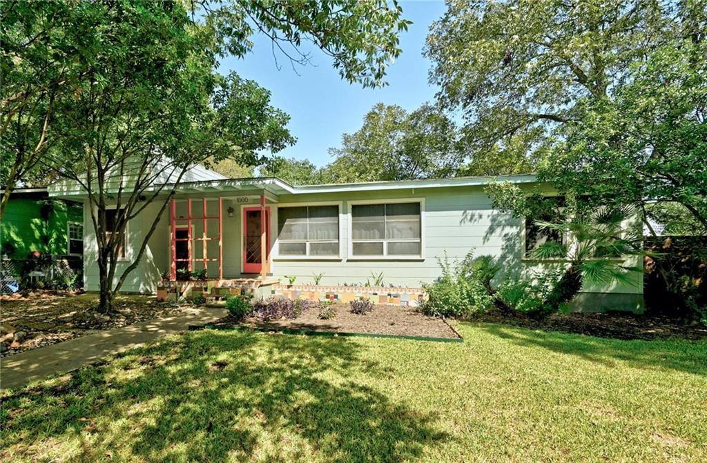 Quintessential SUPER Cool S. Austin bungalow in the HOT Southland neighborhood just behind South Austin hospital (on the grid). This beauty is on a spacious double corner lot! Plenty of room to stretch out and enjoy your palatial urban spread hosting awesome backyard parties OR build up or onto the original house OR build a whole new second dwelling. The skies the limit!  This lovely home has some special features. There are two entrances allowing you to have a separate guest entrance for Air BnB or just private guest quarters with high ceilings and a spacious full bath. The main home has phenomenal natural light through out, gleaming original hardwood floors, beautifully updated main bath, a lovely kitchen with ample storage and a commercial fridge, open living/dining floor plan with cool original built ins, and a HUGE modern laundry/mud room that leads to a sweet back deck overlooking the expansive backyard. Come check this out this rare gem for yourself.