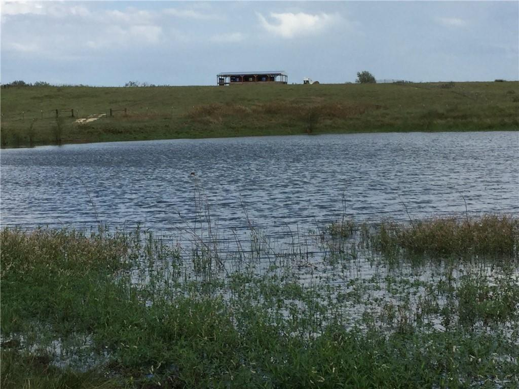 Gorgeous 11.926 Acre horse/cattle farm fully fenced with 40'x60' custom horse barn. Enjoy beautiful skyline views and sunsets. Large pond full of fish. Minutes from Famous Coupland Dance Hall and about 10 minutes from Elgin and Taylor. Some deed restrictions. Water and Electricity are available.