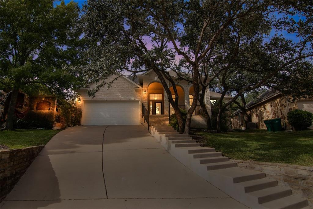 Prime location at the edge of Texas hill country, this 3 BR plus office one level home in Volente Hills features an open-floor plan, soaring ceilings, archway entries, bamboo floors, vast views of the tree-lined backyard and sunlight rooms throughout! The spacious kitchen includes a center island, sprawling counter space with plentiful cabinetry, a breakfast nook and recessed lighting. The grand living room showcases an entire wall of windows, an inviting fireplace enhanced by floor-to-ceiling white stone and a separate dining area, perfect for hosting gatherings. Spacious Primary bedroom features vaulted ceilings, crown moulding, wall-to-wall backyard views & spacious ensuite. Dual vanities, garden tub, separate shower and huge walk-in closet. Working from home is easy from the large office/study with twin arched windows and a beautiful view. Enjoy the sizeable backyard retreat with mature trees and expansive wood decking, great for outdoor living. Shopping, dining, commuter access, Lake Travis attractions & LISD schools are only minutes down the road!