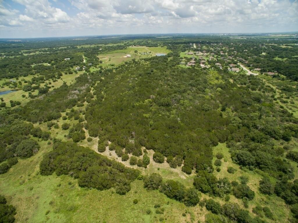 Own your own piece of the heavenly Texas Hill Country in a superior location! 78 acres +- of beautiful hill country land.  Superior building sites with stunning views for miles. This property is loaded with beautiful oak trees, 2 ponds, and an abundance of wildlife game including white tail deer, axis deer, wild turkeys, & bobcats. Located in the ETJ of Kyle, just minutes from sought after restaurants like Hays City Store, Trattoria Lisina and the infamous Salt Lick BBQ. This property is part of 113 acre tract, in which the seller is selling off 78 acres. Call or text to schedule an appointment to come view this picturesque land today!