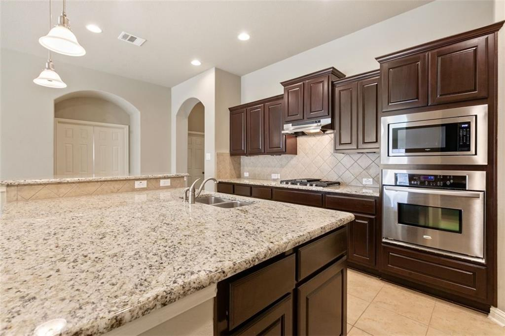Amazing 1 story 4 bedroom, 3 bath with dedicated office.  An entertainers kitchen with a oversized island that can seat 8. Custom cabinets for as butler area and planning desk.