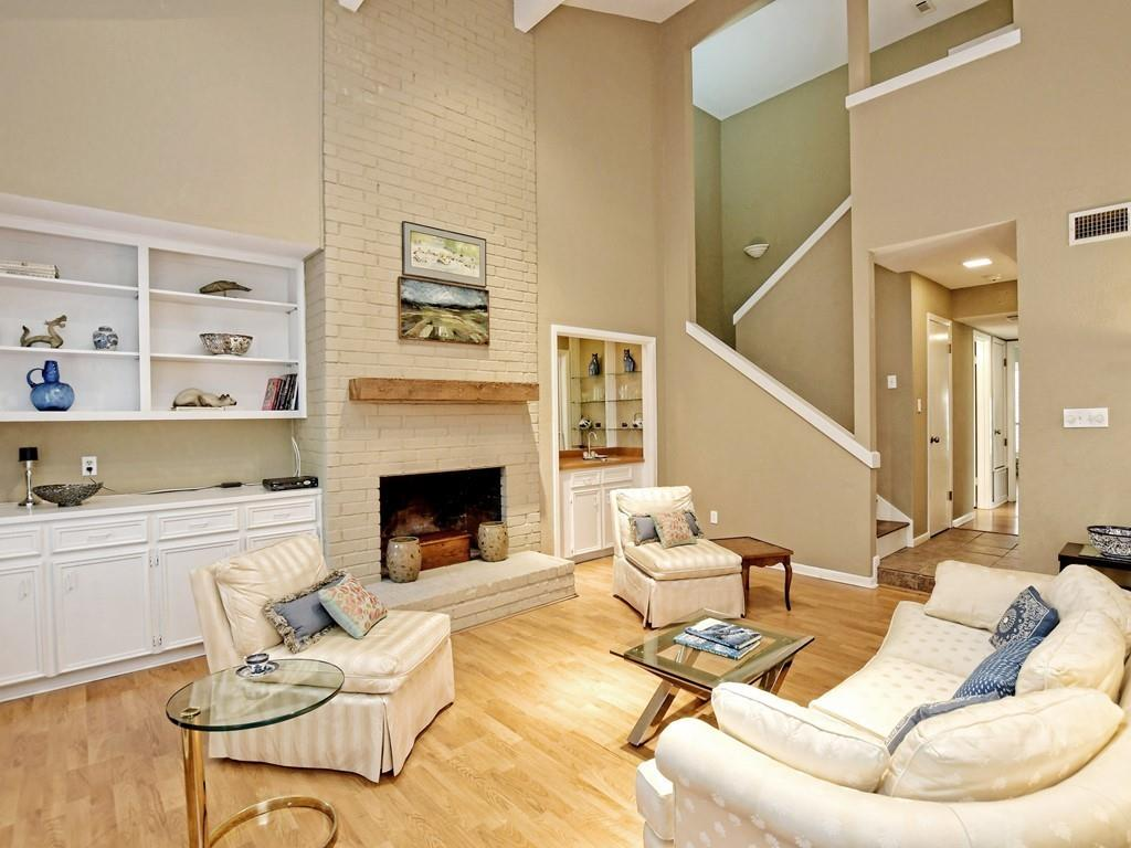 Spacious townhome in very desirable The Trails. Experience all that NW Austin has to offer in this lovely neighborhood. which is a short walk to grocery and other shopping. Very versatile floorplan with either an upstairs primary bedroom suite or a downstairs bedroom with full bath in hallway.  The downstairs bedroom/study/living area has so much versatility and has a lovely view of the private courtyard. (Several Doors were removed by previous owner but stored in attic if new owner would like to reinstall.) The living area features soaring ceilings and lots of light.  A wood burning fireplace is perfect for winter evenings.  The HOA maintain all landscaping and grounds including the irrigation. This home offers so much and is ready for you to put your personal touches on it.