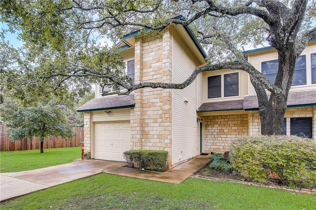 Must see to appreciate the superb location for this charming end unit townhome with updates. Surrounded by beautiful established trees, this 3 bedroom 2.5 bath home offers a functional layout designed to make relaxing, or entertaining a breeze. A light and bright large living area with fireplace flows to an open dining space with contemporary lighting and an adjacent kitchen offering a pass through bar, white cabinetry, quartz counter tops, stylish backsplash, and ample storage. Easy to maintain tile flooring on the main level, and crown molding are some of the special features that can be found throughout. Retreat to spacious primary bedroom with updated carpet, and numerous windows taking full advantage of picturesque tree top views, plus an en-suite bath with dual vanity sinks and combined shower/tub. Two additional bedrooms features wood floors, crown molding, ceiling fans, and share a full bath. Enjoy outdoor living under a covered patio overlooking a private, fenced-in shaded yard requiring little to no maintenance with artificial turf and pavers. This community offers a swimming pool, and is just minutes away from exploring the trails of Walnut Creek, shopping or entertainment at The Domain, and convenient to North Austin's tech corridor.