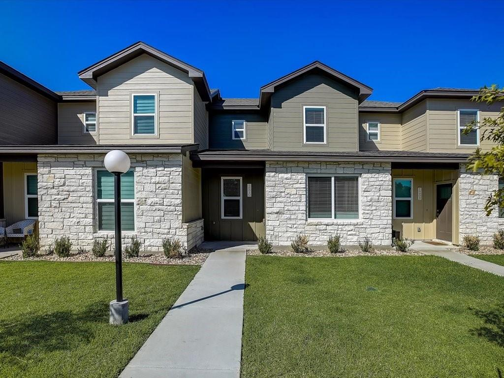 Charming two-story townhome on a cul-de-sac lot! The inviting floor plan showcases hardwood floors and light filled spaces. Kitchen has an abundance of storage,  center island, granite countertops and SS appliances. Large master suite comes with a shower, double vanities and a walk-in closet. Perfect for outdoor living, this town home is a block away from the lake and has gorgeous views of the golf course!