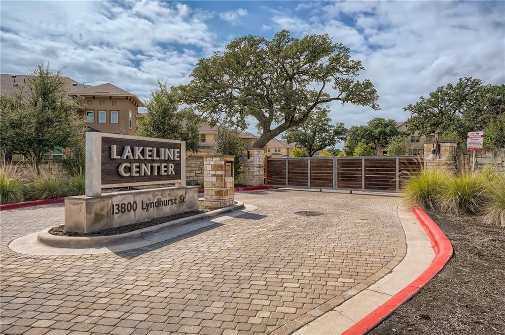 Coveted end unit just steps from the beautiful community pool at Lakeline Center Condos. Charming and spacious 4 bedroom, 3 full bath condominium in NW Austin is loaded with amenities. Built in 2018 with tons of upgrades. Quartz countertops, real wood blinds throughout, recessed lighting, ceiling fans in every room. Tile downstairs, with wood floors in downstairs bedroom. Master and two bedrooms up. Oversized master bath with shower seat, elongated 1/3 offset ceramic tile, shaker style cabinets, large laundry room with plenty of cabinets and a folding station. Overhead storage racks in the oversized 2 car garage, complete with twin water heaters. Condominium is a 5 minute walk to the Lakeline light rail station and close to everything in NW Austin. Two hospitals are currently under construction right around the corner. Development is gated, has a pool, and plenty of green space for walking your pets.