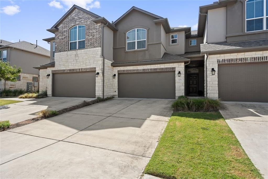 Beautifully maintained townhome in Carrington Court features gracious open floorplan and is a perfect full time residence or second home.  Kitchen is nicely appointed with rich cabinetry, granite counters, decorative stone backsplash and a large island that doubles as a breakfast bar.  Dining area includes cozy window seat and a door to the covered patio.  Luxurious wood flooring, crown molding and recessed lighting are some of the extras to be found in this home.  Upstairs primary bedroom and bath contains dual sinks with recent Moen faucets, separate tub and a shower, each with modern tile surround and an oversized walk in closet.  Two additional bedrooms and another bathroom provide space for everyone.  Loft creates ideal office nook.  Fully fenced back yard with sprinklers.  Lawn care included in HOA dues.  Great location minutes from everything!