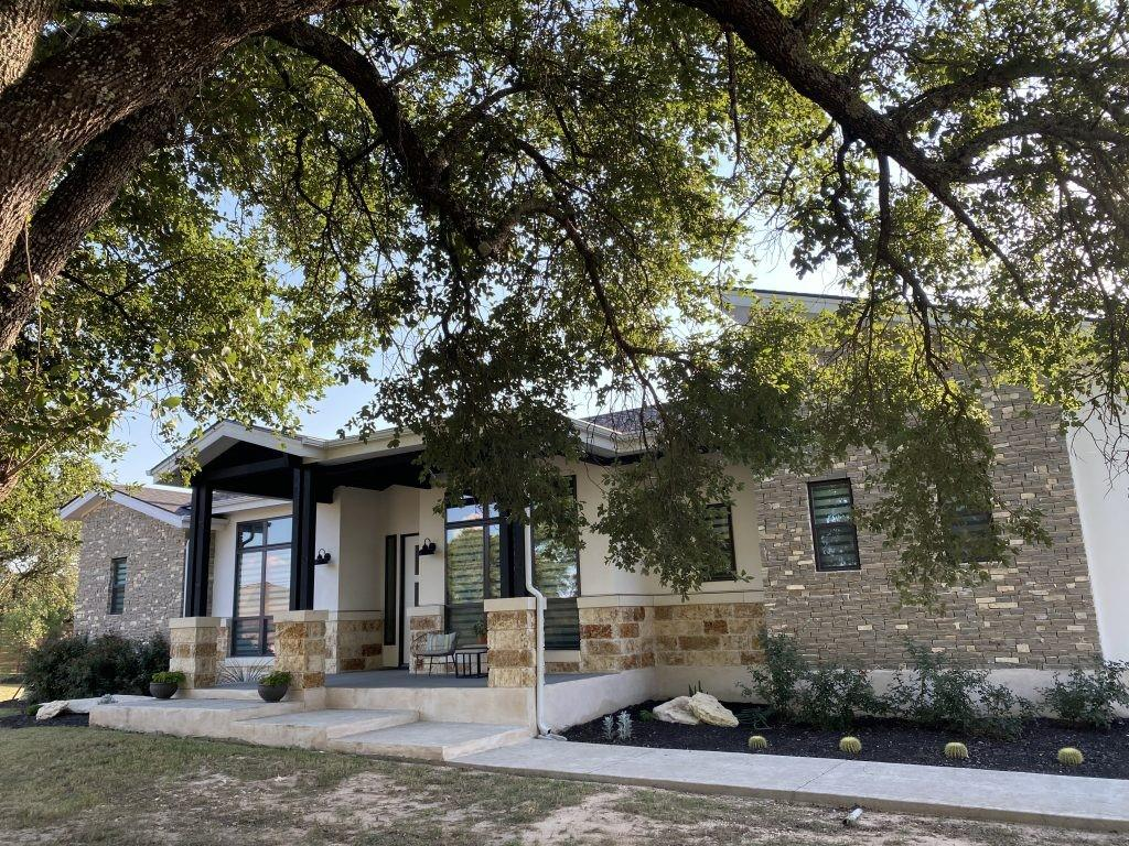 """Gated subdivision, 2 acre lot! 3502 sq/ft single story home w/ white stucco, upgraded rock exterior w/ over sized  Mexican brown stone & level 5 """"Cave Stone"""" which is pulled from bottom of caves! Detached 3rd car garage w/ heated/cooled room! High end appliances w/ 48"""" Thermadore range, double oven, tongue/groove wood ceiling, architectural wood beams, pot-filler, wood cabinets w/ dovetail/soft close drawers, massive covered patio, granite/quartz, modern gas fireplace & HUGE sliding doors! Complete home water softening system. Executive pool with spa and outdoor kitchen."""