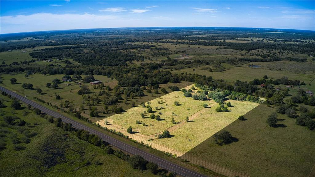 10.1 Ag Exempt Acres that are perfect for a country residence or rural non-agricultural commercial operation. Located ~10 minutes south of Smithville, Texas, this acreage is convenient to the city while still providing an escape from the hustle and bustle. With ~500 ft of Highway 95 frontage, you have plenty of space to get a TXDOT approved entrance for the tract. The lot is relatively flat with scattered trees including some nice Live Oaks and Post Oaks with a wet weather creek toward the back. There are several good building sites and the current owner plans to implement some light restrictions to protect your investment.