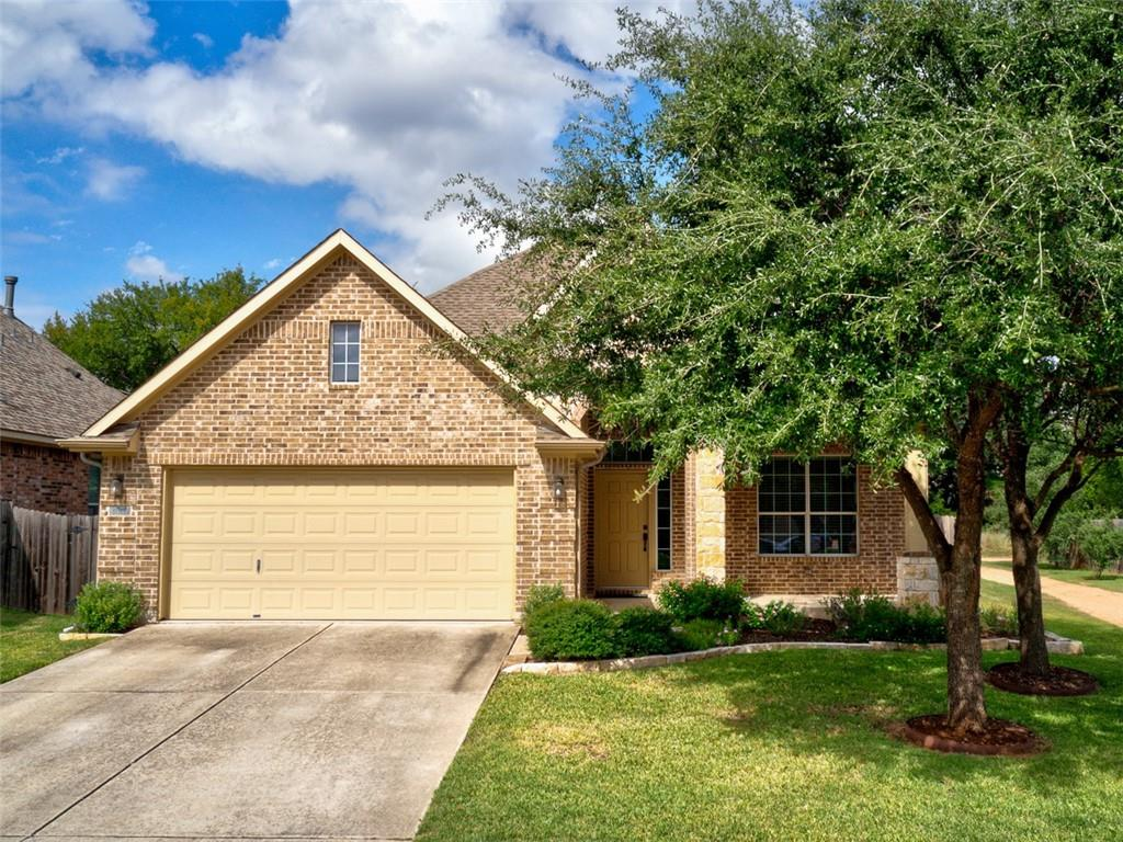 Beautiful one-story home located in the desirable Ranch at Brushy Creek overlooking nature trails for wonderful seasonal views. The covered porch and landscaped beds greet you as walk into your spacious front foyer. Featuring 10 foot ceilings throughout, your home unfolds with the formal dining room at the front of the home, currently serving as a home office. The foyer leads into the main living areas which open to each other. The large central island in the kitchen has ample counter space for prep work and entertaining, as well as the option for breakfast bar seating. From the spacious granite countertops to the poplar cabinets with under-cabinet lighting to the quality, natural gas appliances, your new kitchen creates a wonderful flow for upcoming holiday gatherings. Adjacent to your kitchen is a breakfast area and the main living room. Grab a quick bite or relax in front of your fireplace, watching your favorite movies with the wired rear sound system or enjoying the view of nature through your large back windows. Your primary suite, located at the rear of the home, is separate from your guest bedrooms. Its adjoining bath features double sinks, separate garden tub and large walk-in shower, as well as a walk-in closet built for two. The sizeable guest bedrooms are located at the front of the home, with a nearby utility room that feeds off the garage – which has an exterior door leading to the backyard as well as a large utility sink. Your backyard oasis awaits, with extensive Texas landscaping and a quaint flagstone patio perfect for wildlife watching or summer evenings. Mature live oaks dot the property, offering shade. The community feeds into the highly rated Round Rock Independent School District, boasts multiple playgrounds, parks, pools, a dog park, sports courts, lots of trails, and is within walking distance to the Brushy Creek Regional Trail System. Easy commute to 183, Mopac/Loop 1, SH 45, and I-35 with a short drive to major shopping in all directions.