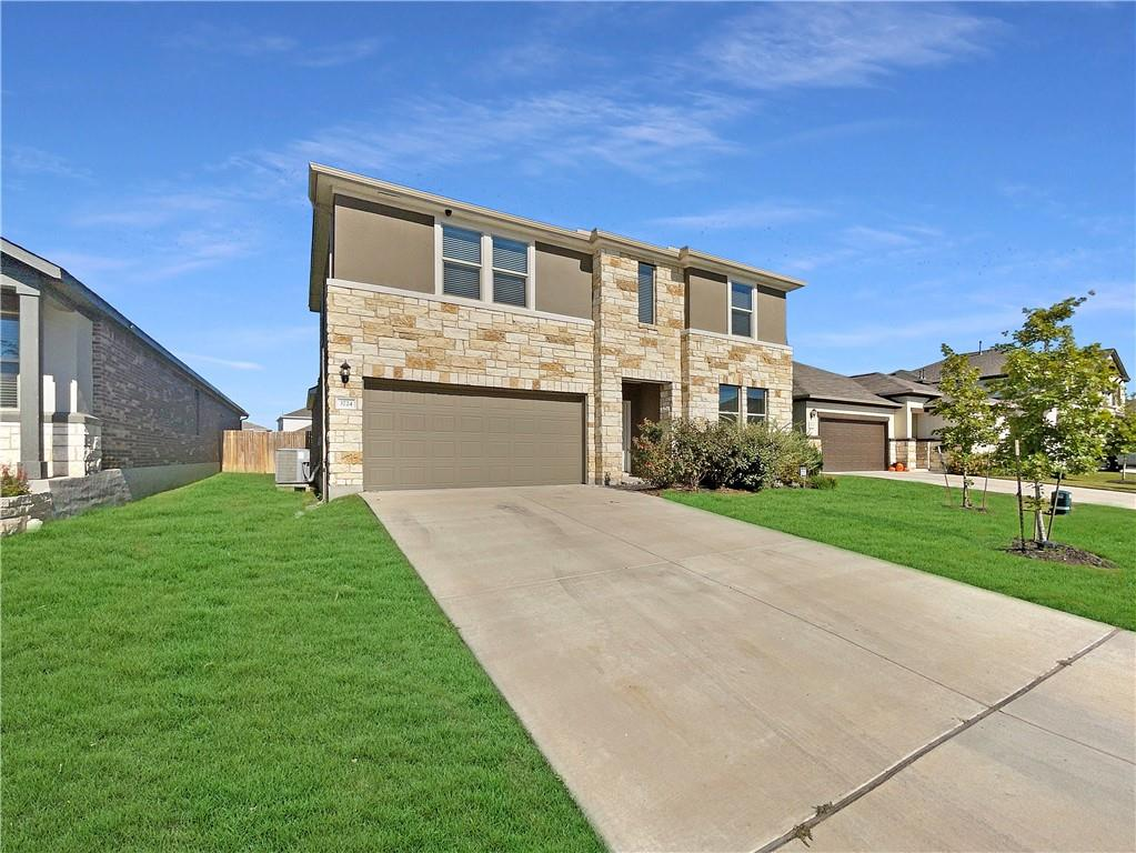 Built in 2018, this Pflugerville two-story home offers a patio, quartz countertops, and a two-car garage.