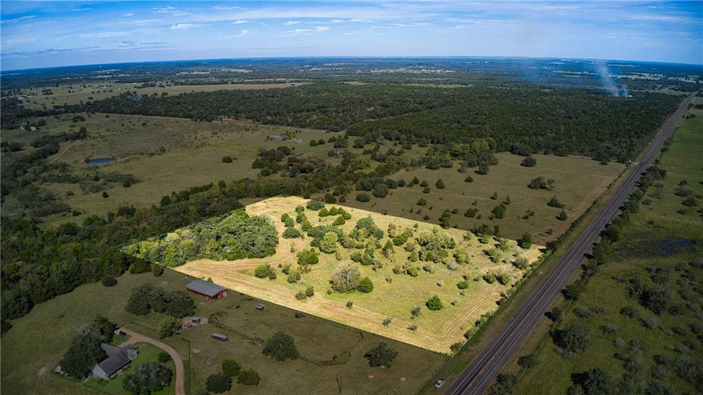 10.1 Ag Exempt Acres that are perfect for a country residence or rural non-agricultural commercial operation. Located ~10 minutes south of Smithville, Texas, this acreage is convenient to the city while still providing an escape from the hustle and bustle. With ~500 ft of Highway 95 frontage, you have plenty of space to get a TXDOT approved entrance for the tract. The lot is relatively flat with several good building sites and beautiful scattered trees, including some nice Oaks. A pond is nestled in a grove of trees toward the back of the property. The current owner plans to implement some light restrictions to protect your investment.