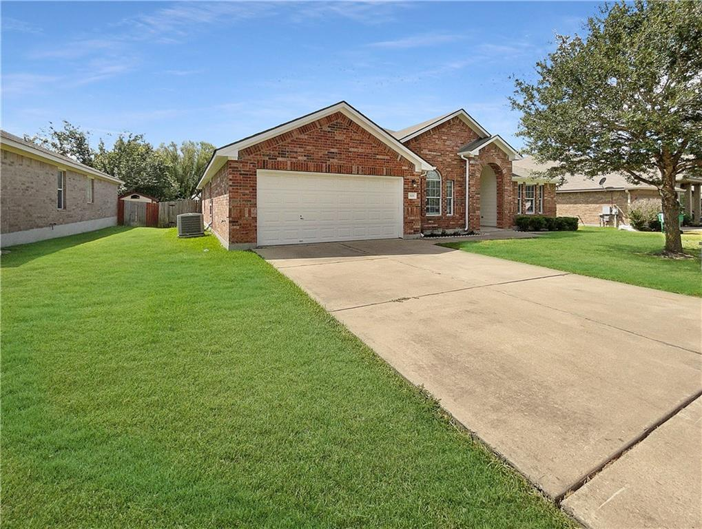 This Pflugerville one-story home offers a two-car garage.