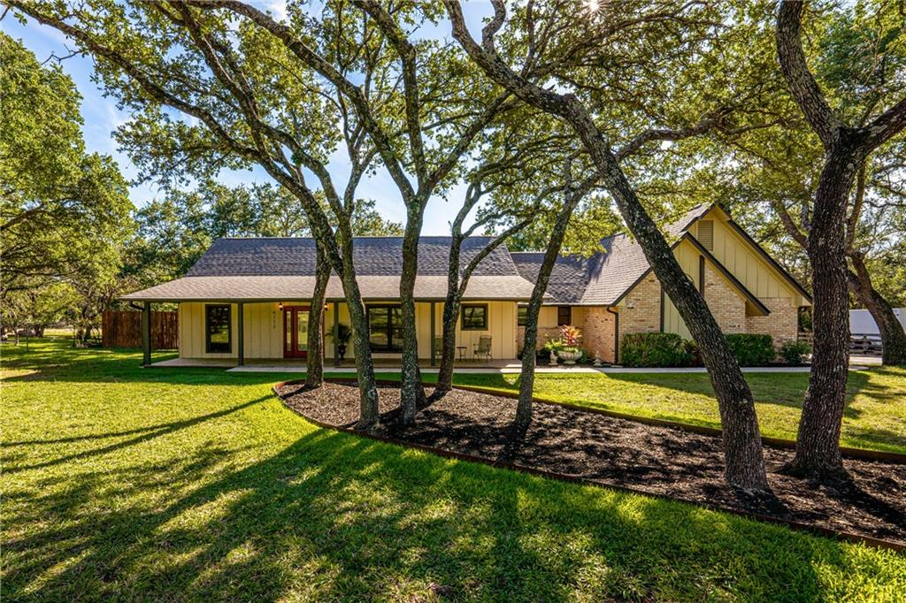 """1.2 acre wooded lot. Completely remodeled ranch-style single story home on cul-de-sac that is MOVE IN READY with upgraded energy efficient windows and doors, new AC 2021, new roof 2021, new secondary bedroom carpet 2021,  """"super"""" fitting room style master closet,  Italian hickory kitchen cabinetry, wine bar, coffee bar, granite countertops and charging stations galore.  All electric appliances convey, including washer and dryer. Outside enjoy the mulitple decks and porches, swimming pool with custom redwood deck, large outdoor living/playing spaces and gardens, covered grill area, 8 foot cedar privacy fence. 1800 sq foot """"steel man cave"""" with 500 feet of mezzanine, plumbed for bathroom, 12 ft high and 20 ft wide commercial door and side pad parking for motor home, boat etc. Additional, 1 ½ car size """"She shed"""" / studio at rear of property. Yard tools, including riding lawn mower and power washer also convey and are stored in a separate garage on the back of the property. No  HOA or city taxes."""