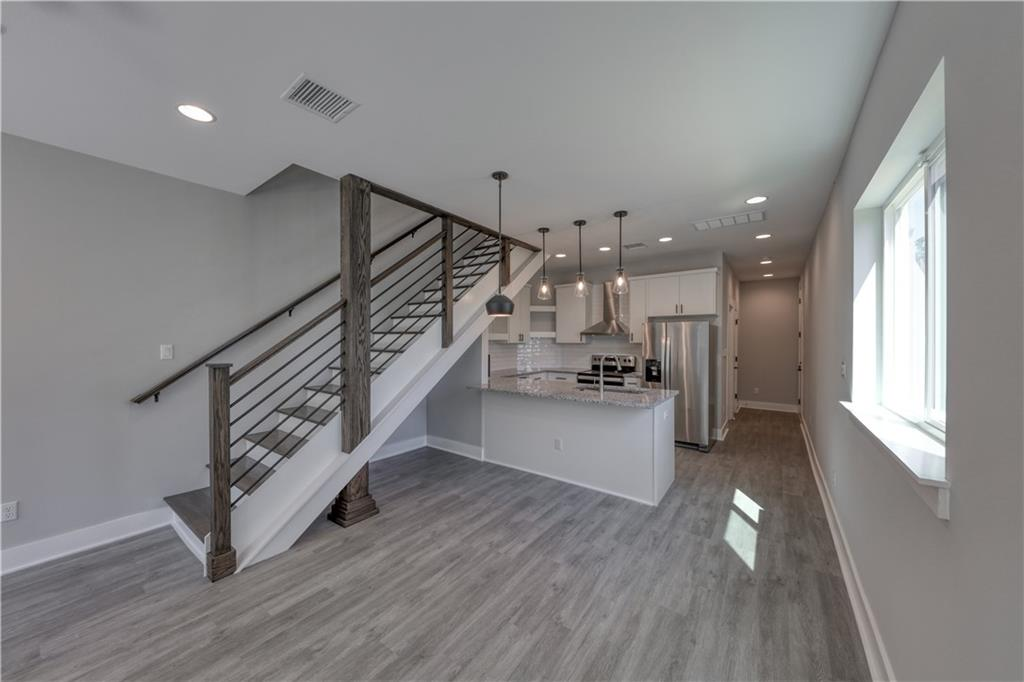 Brand New Construction. 3 Bed / 2 1/2 Bath/ and 2 car garage. Each unit is 1451sf. Solid slow close wood cabinets, granite counter tops, 9ft vaulted ceiling bedrooms and  laundry room downstairs. Private second story balcony. Lake access less than a mile. POA membership has lake park access, boats ramps for members, pool and fitness center.   Private Golf Club access optional. Restrictions: Yes Title Company is Texas National Title - Leah Taggart- Cedar Park. Building Completion Nov 26, 2021
