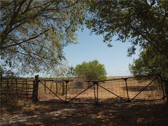 168.42 Acres.  Hwy 80 frontage.  Front portion of property located within the city limits of Martindale, Texas.  Native Grass open land currently in ag. Exempt status 1-D-1.  Cattle on property, please keep gate closed.Restrictions: Unknown
