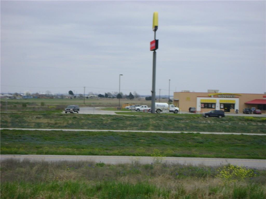 +/- 10 acres on 183 and toll road 130, have site plan and permits for Hotel, 5 car wash bays, 3 automatic truck wash bays, and a few other buildings, close to F1, and airport.2000 plus houses have been permitted in a 5 mile radius of this property.Restrictions: Yes