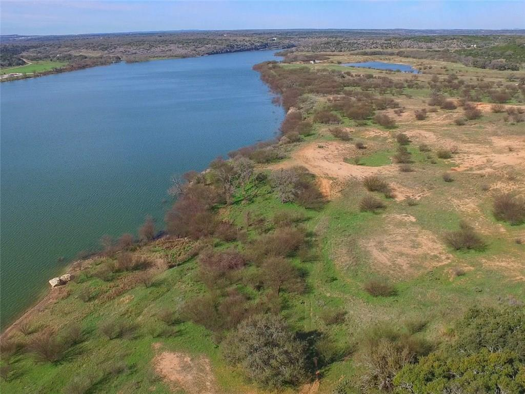 This picturesque ranch has it all.  From  breathtaking views to Lake Travis shoreline frontage, has all of the attributes that makes it one of the outstanding ranches for sale in the Highland Lakes/Hill Country of Texas. Whether the property is developed or kept intact,  buyers will have many options and opportunities with this w  Lake Travis frontage is approximately 1,900 feet.  This unique property is sprinkled with four   lakes/tanks, grandiose views.FEMA - Unknown