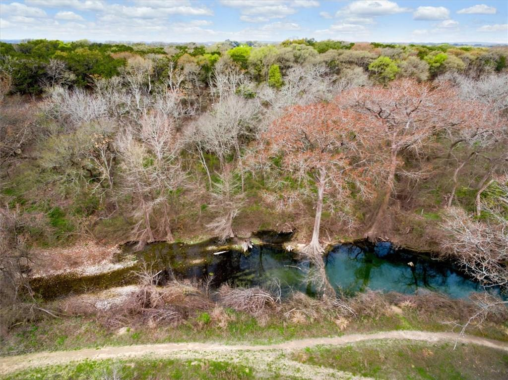 Property is located in Driftwood TX and when the wind is blowing from the right direction you can smell the BBQ.   Large oak tree at the entrance to the property, terraced pasture land and several mature oaks.  Beautiful sunset and hill country views.    The entire property consists of 68.66 acres.  Seller has decided to sell +/- 61 acres (instead of the 12.66 acres) and  retain home and 7 acres.  The property includes approximately 1000 feet of Onion Creek.    Call agent for appointment to show.Restrictions: Yes