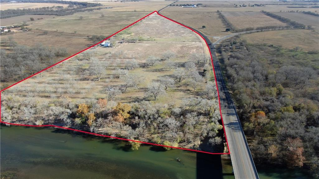 47 acres at the intersection of FM 969 and Fm 1209. Future entrance to Master Planned community. Close to new Tesla plant! Colorado River frontage!
