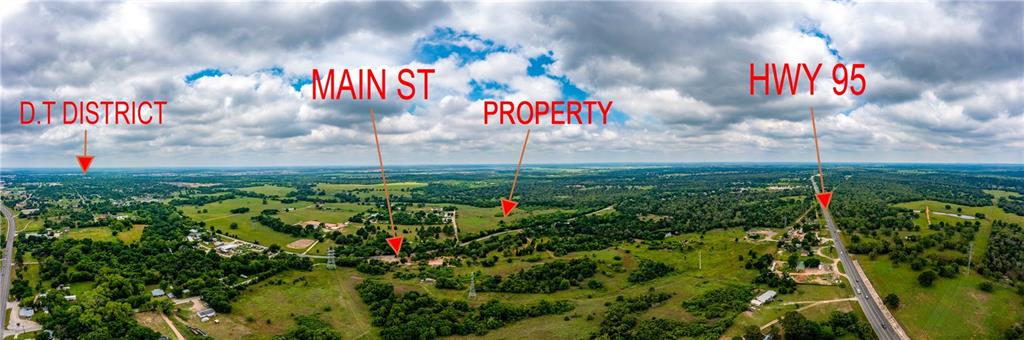 Buyer must be accompanied by their Agent/Broker.  Contact your Broker/Agent for a showing.  Do not cut any portion of the fence to access the property. Approximately 1,400 ft of frontage along west side of N. Main St; approximately 1,000 ft of frontage along north side of Hiway 40. (See green highlights on uploaded BCAD Web Map.) No flood insurance is required by FEMA according to FEMA Map 48021C0215E, Date: January 19, 2006, Zone X.  Waterline marked by Aqua Water Supply Co. at N. Main St. & Hiway 40. (See blue flag and blue marking on site.)  The parcel might be within City of Bastrop's waste water (sewer) CCN, but Buyer/Cooperating Broker should verify if  lines go farther North. Pond on site. Information in this listing should be verified by Buyer as the information is not guaranteed.  Contact the respective entities for any questions regarding the use of the land, improvements, utilities, etc.