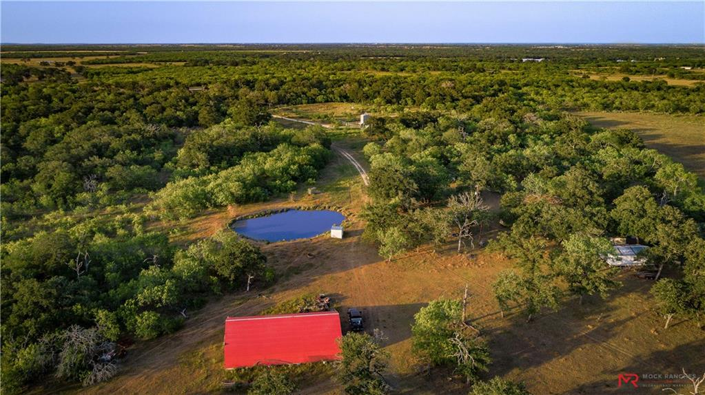 Perfectly square in shape with great county road access and no floodplain, this property is as clean as they come. Mature oaks coupled with south Texas brush, 2 stock ponds, and great native grasses allows the property to check all the boxes from a grazing and hunting perspective. Complete with an 1800sqft barn and a 540sqft camp which includes electricity and water, the Rockin V Ranch is a must see for the recreational buyer looking to purchase a well maintained piece of property they can make their own!Restrictions: Unknown