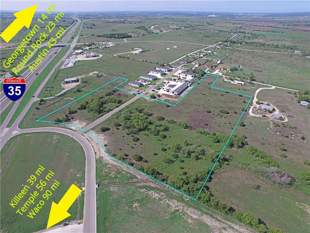 12.390 Commercial Vacant Acres in the heart of Jarrell! Zoned C3 / General Commercial District / Retail / Commercial.  Electric, water, sewer & internet fiber ready for construction! Property is view-able from I35.  Jarrell Town Center is walk-able, where you will find the City's newest commercial development, spanning 46 acres along the I35 southbound frontage road.  The high school is less than 2 mi. Jarrell families benefit from job markets in Austin, Round Rock, Georgetown, Temple, Killeen & Waco.