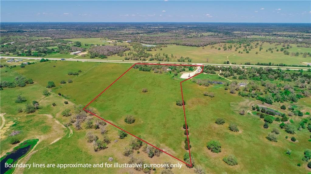 21.457 acres with 792.66' of Highway 290 Road Frontage going eastbound. Existing entrance with a median crossing for convenient access to 290 West, located just outside the Giddings city limits. Scattered oak trees at front which gives privacy, a small pond, barn, and open pasture at the back. Fenced at front (north) and back (south end) with a partial fence on the east side. Mostly flat with fine, sandy loam soils. Bluebonnet Electric power and Lee County Water Supply lines run along the front of the property paralleling Hwy 290 E. Existing oil well pad site at front east corner of property (at entrance). No zoning or restrictions. Great commercial potential here or residential opportunity!